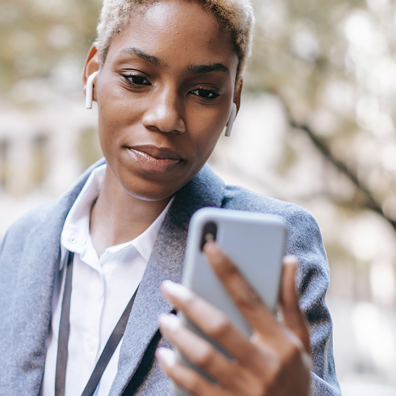 woman checking healthcare information on apple iphone